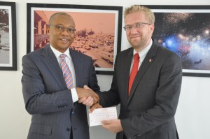 Dr. Wiebe Boer, CEO of The Tony Elumelu Foundation, presents a N1B check for the Victim Support Fund to Vice-Chair, Mr. Fola Adeola in fulfilment of the Foundation's pledge of support for the Fund.