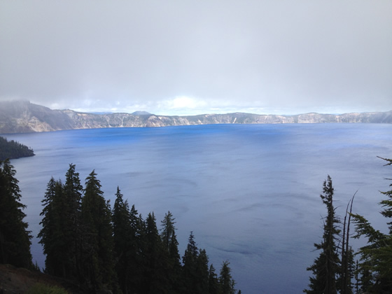 The beautiful Crater Lake, showing a little bit of its radiant blue color in the middle of the picture.