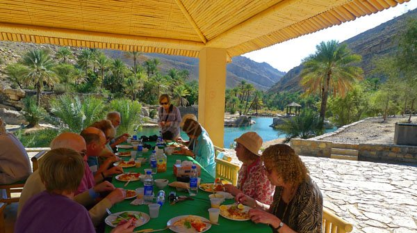 Lunch in an Omani Wadi for an Oman Small Group Tour
