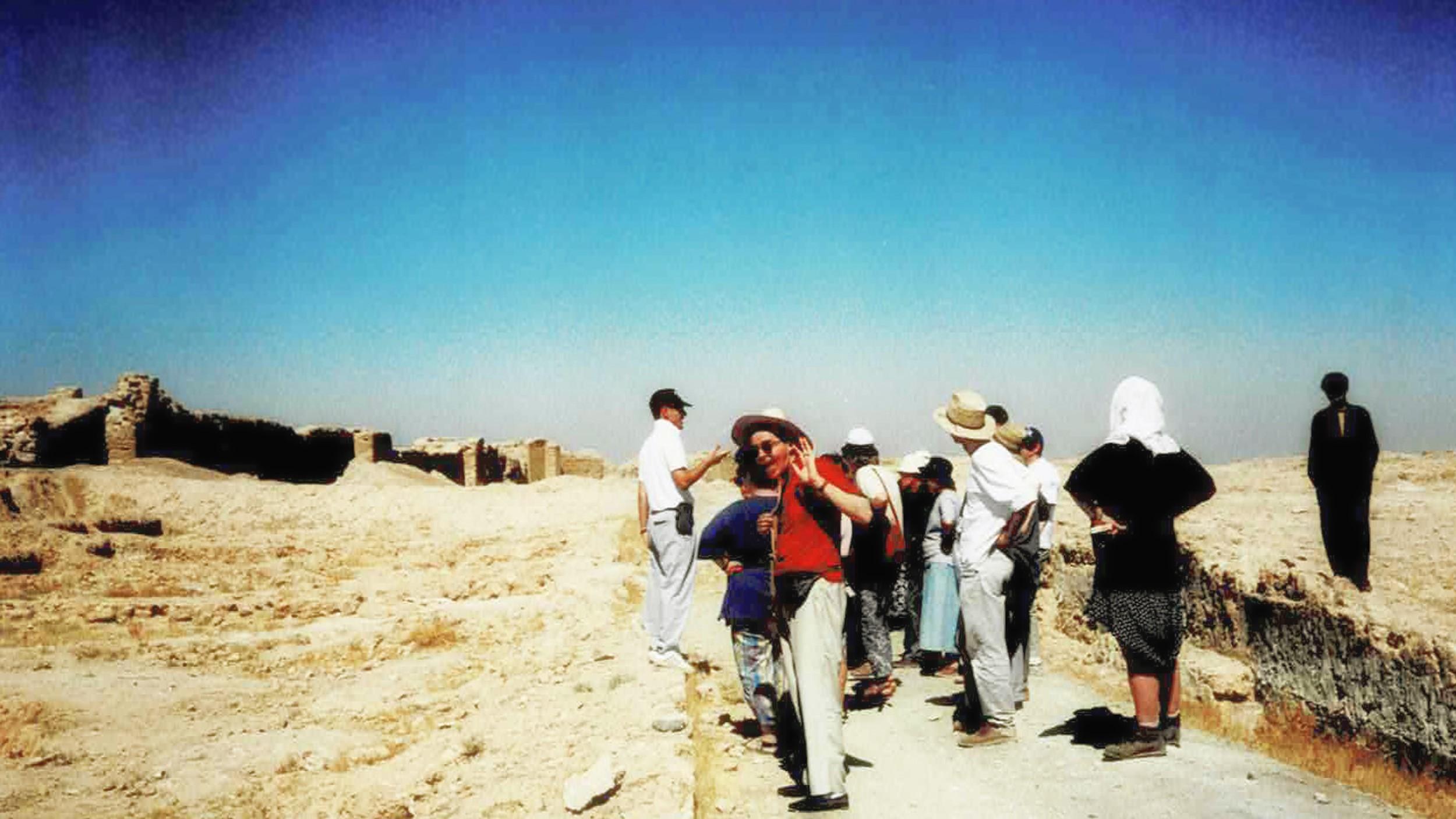 Tour group visiting desert ruins