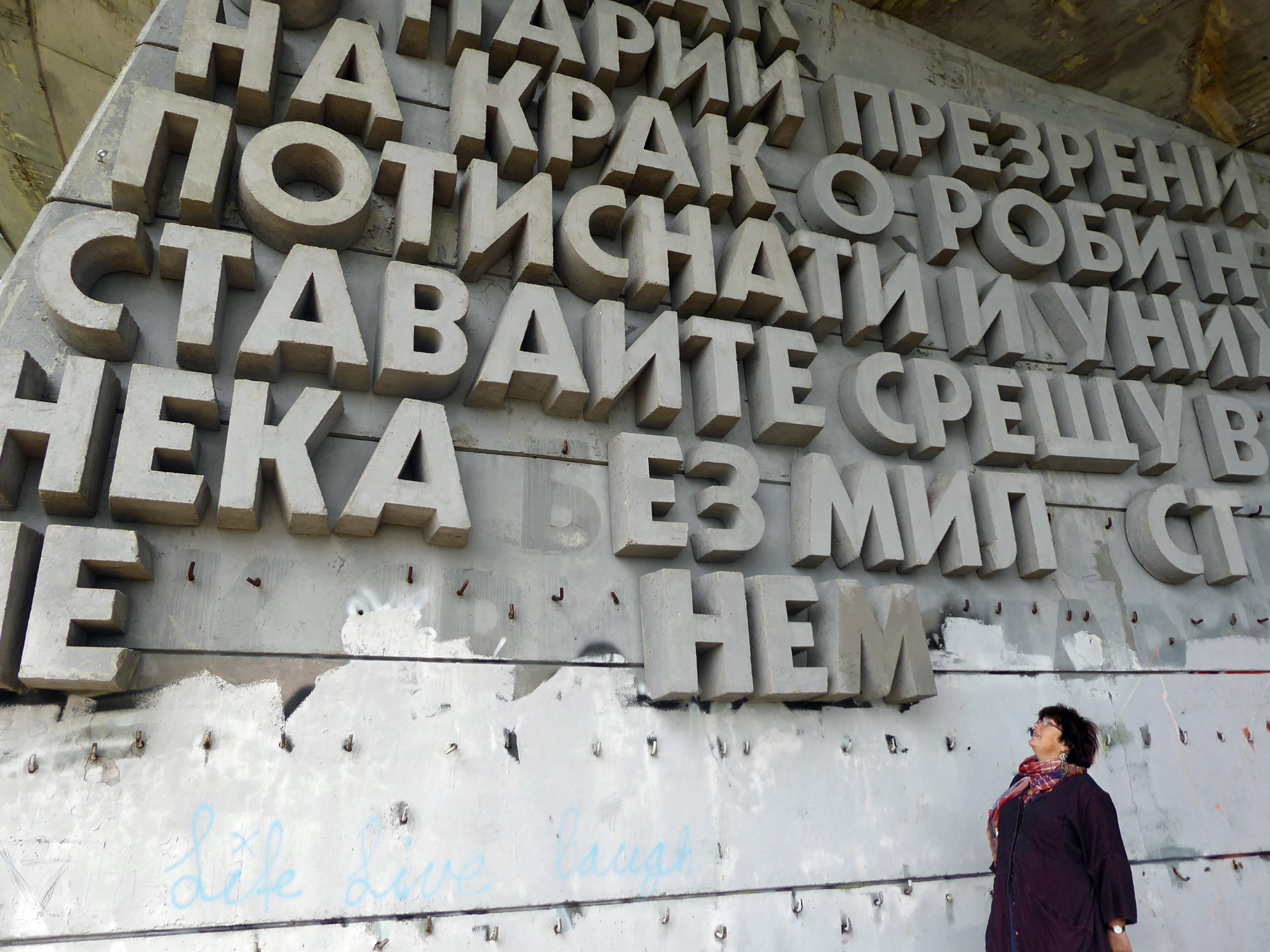 Lady looking at concrete lettering