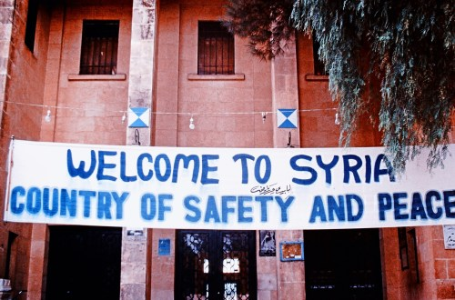 'Welcome to Syria' banner