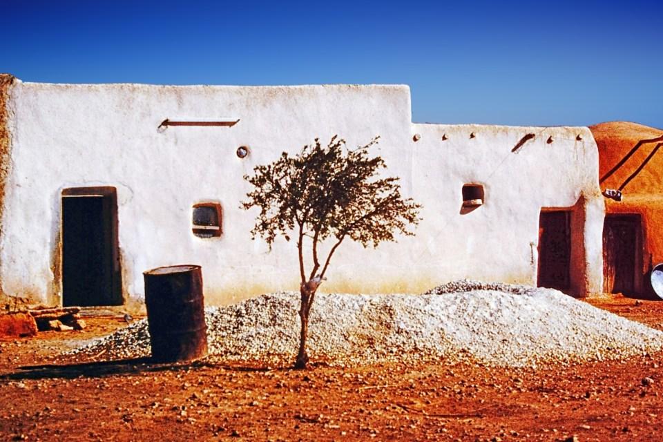 White-washed adobe house