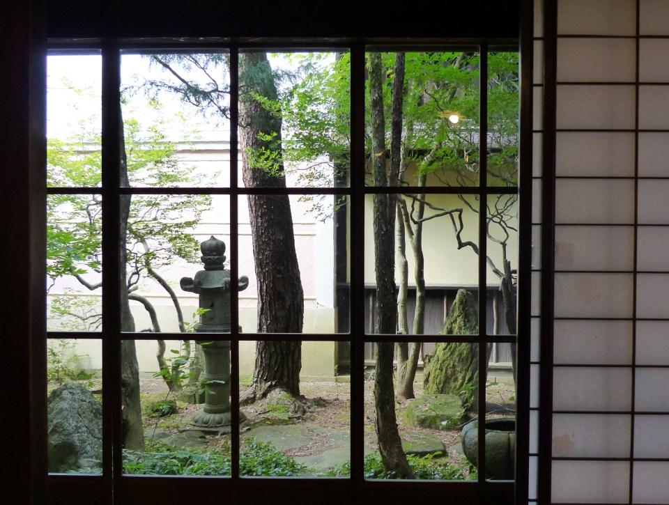 Garden seen through Japanese window