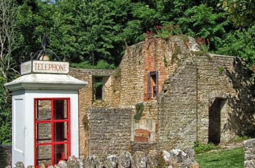 Ruined houses and white telephone box