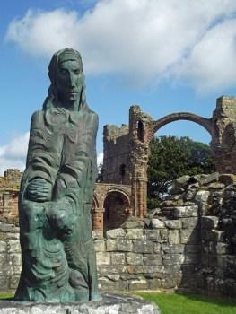 Modern statue among church ruins