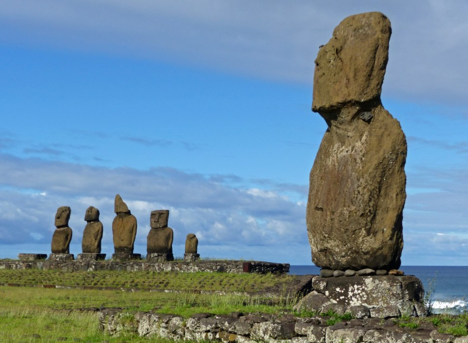 Single moai with row of five beyond