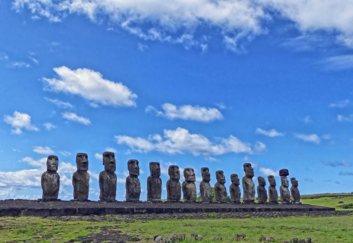 Row of moai against a blue sky