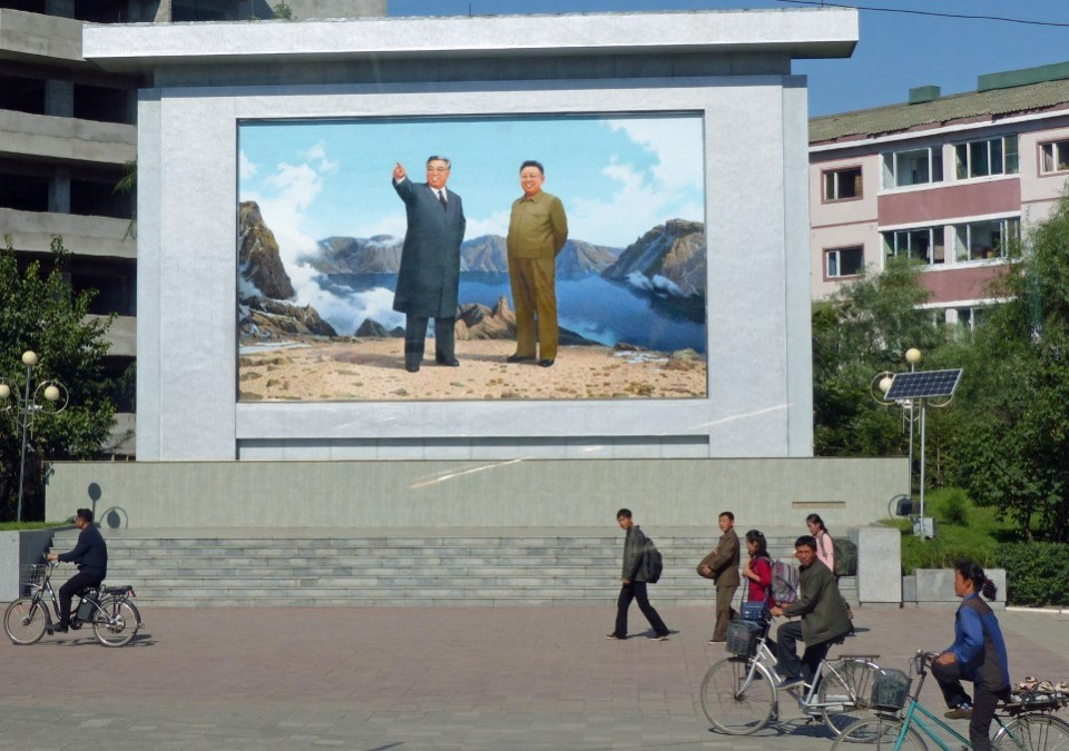 Mosaic of Kim Il Sung and Kim Jong Il on mountain top