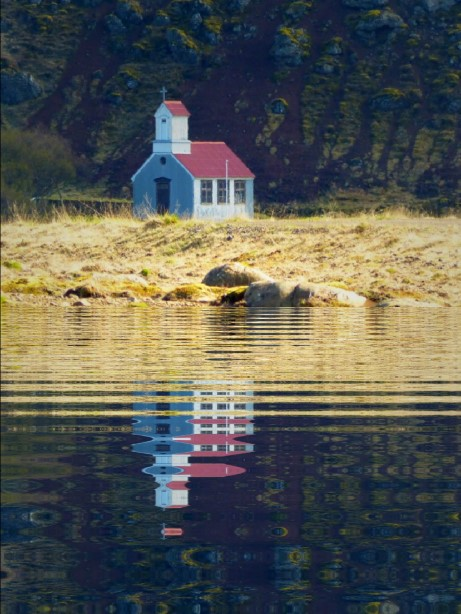 Small church with rippled reflection in front