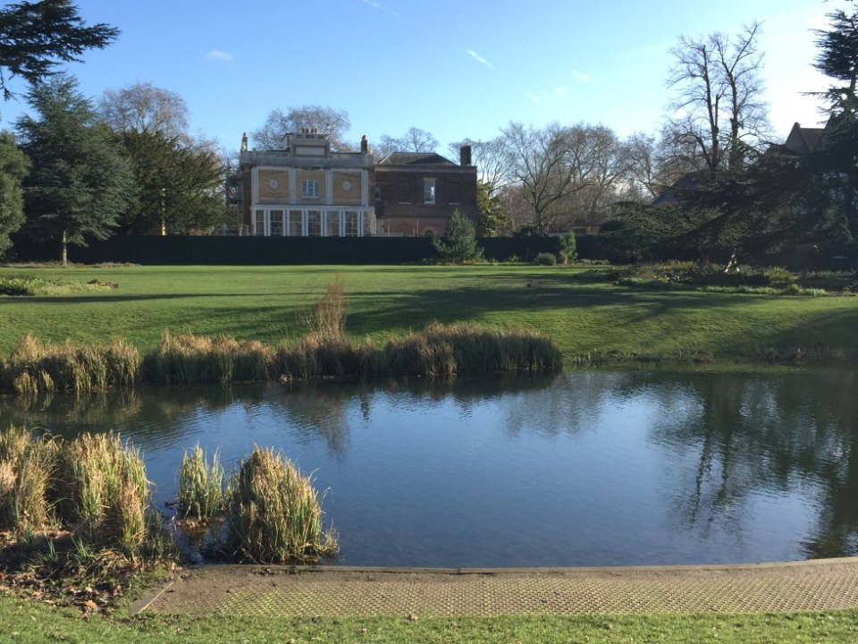 Pond with large house beyond