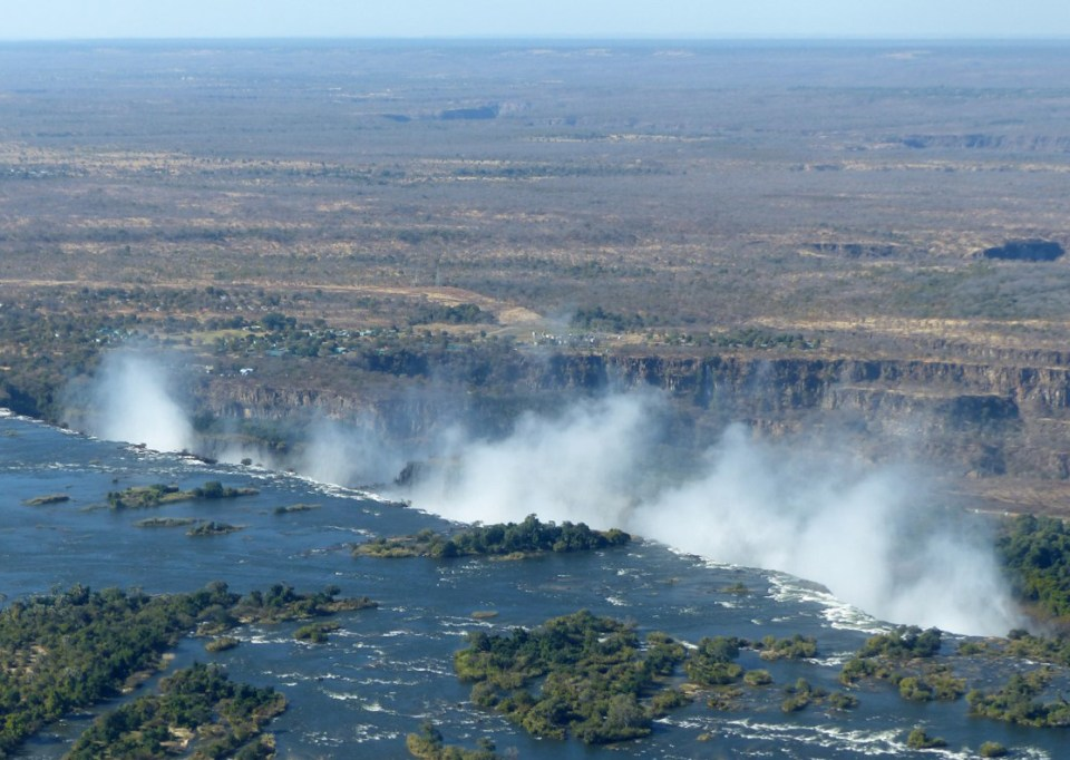 River with spray from the falls and plains beyond