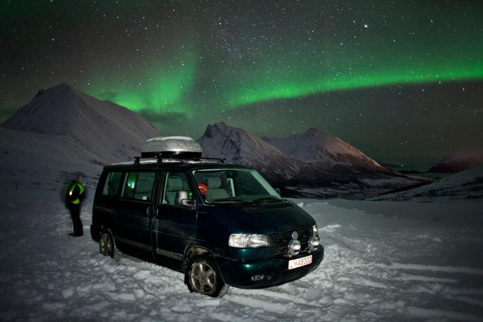 Green Aurora with van in foreground