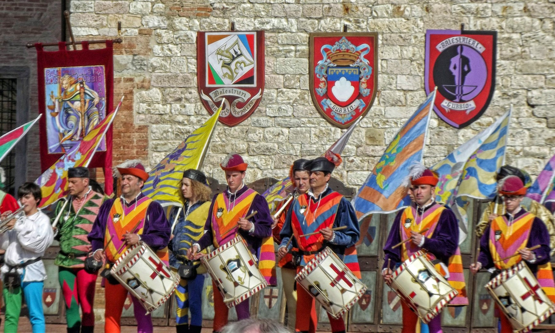 Colourful drummers and flags