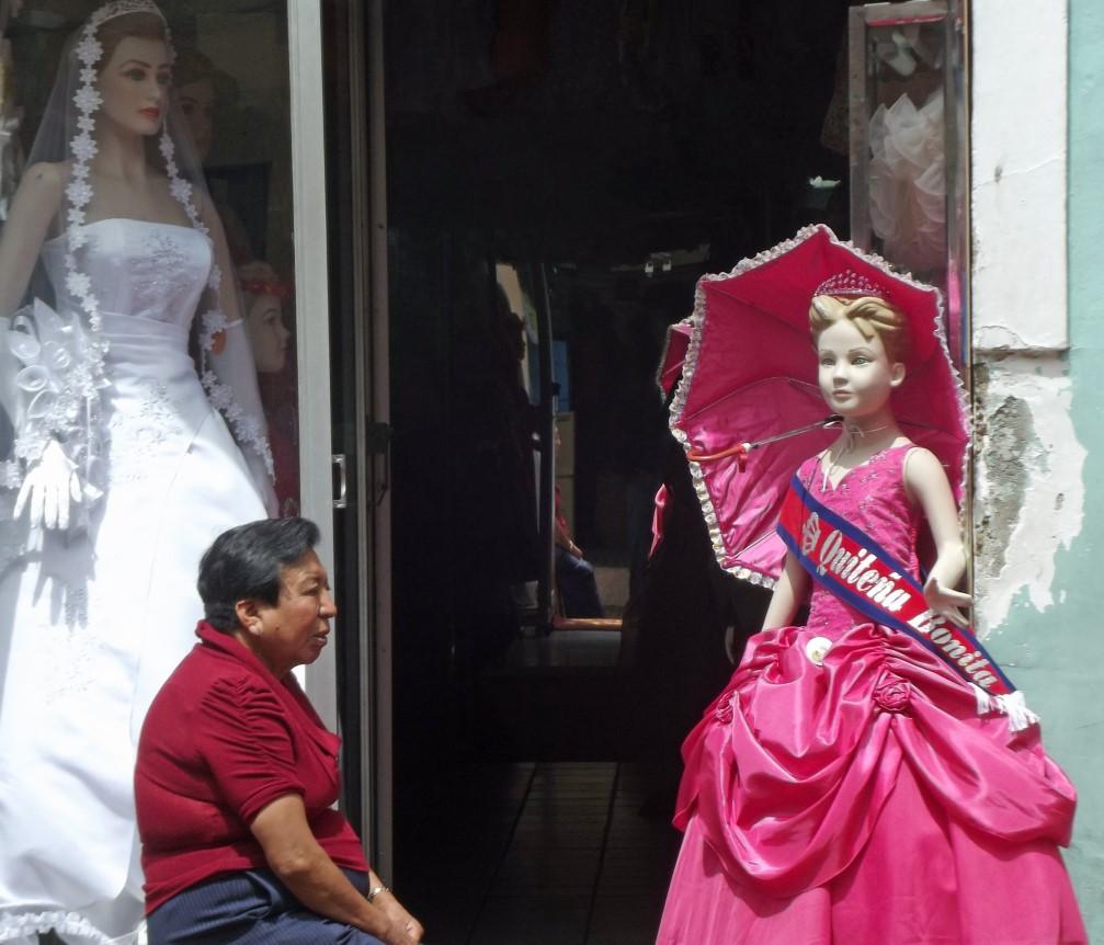 Man sitting outside bridal shop