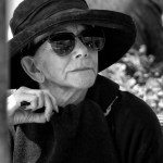 Elderly woman in black hat and sunglasses