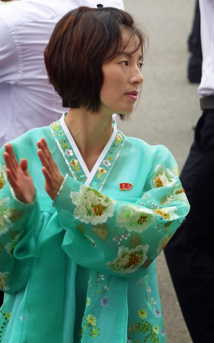 Woman dancing in traditional Korean green dress