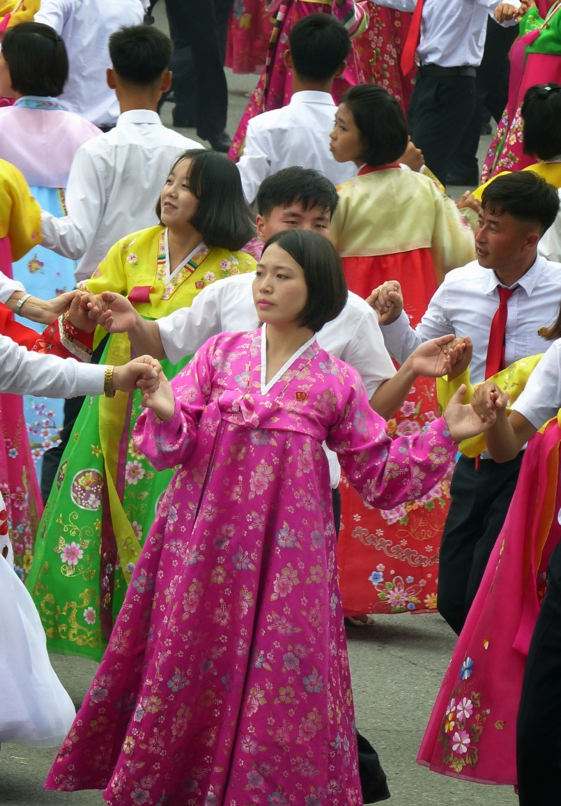 Woman dancing in traditional Korean pink dress