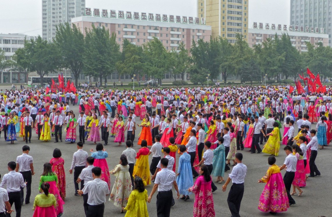 Large group of dancers in traditional Korean green dress