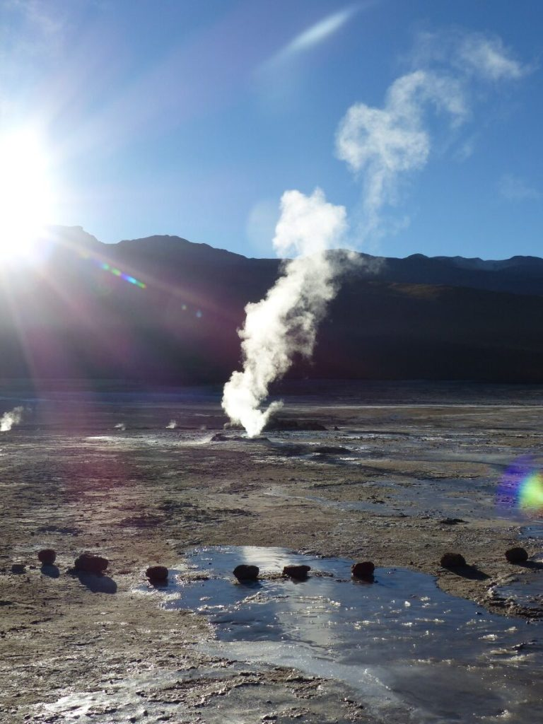 Hot steam rising in front of sun