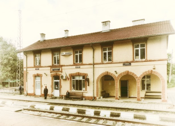 Small station building in faded sepia tones
