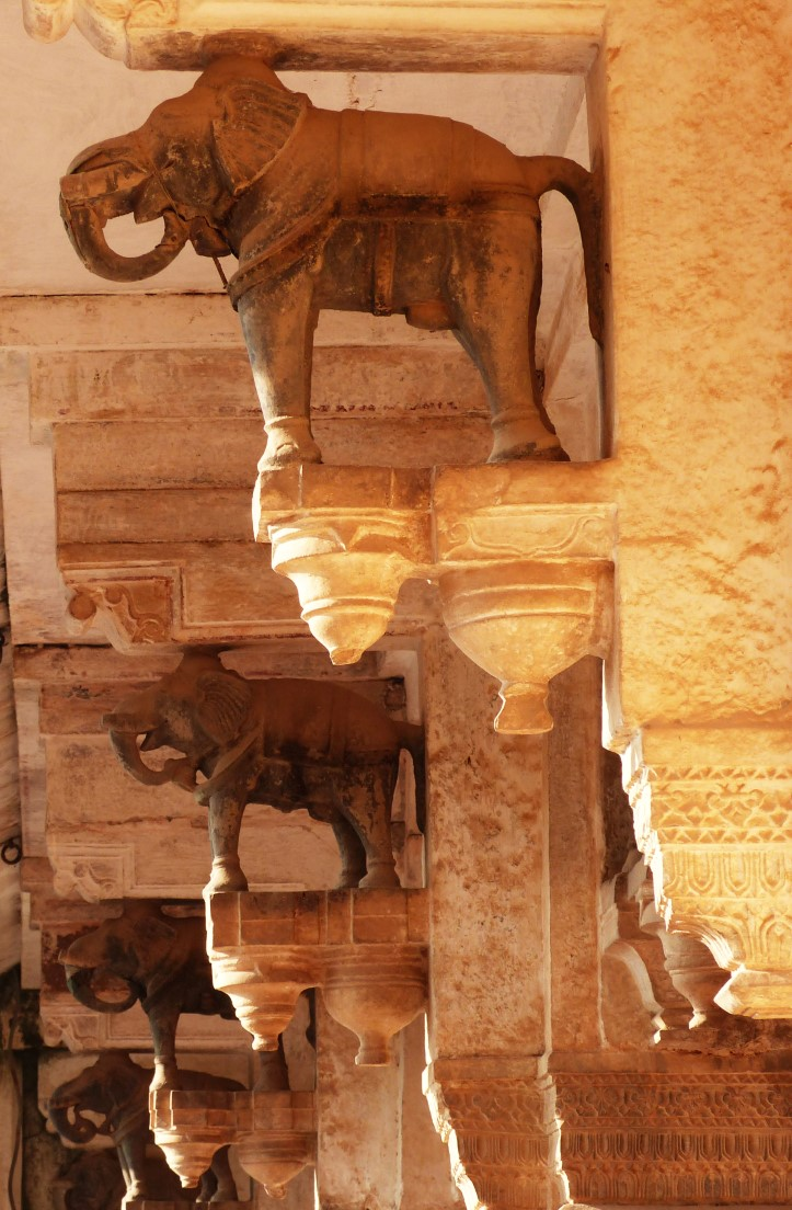 Stone pillars topped with carved elephants