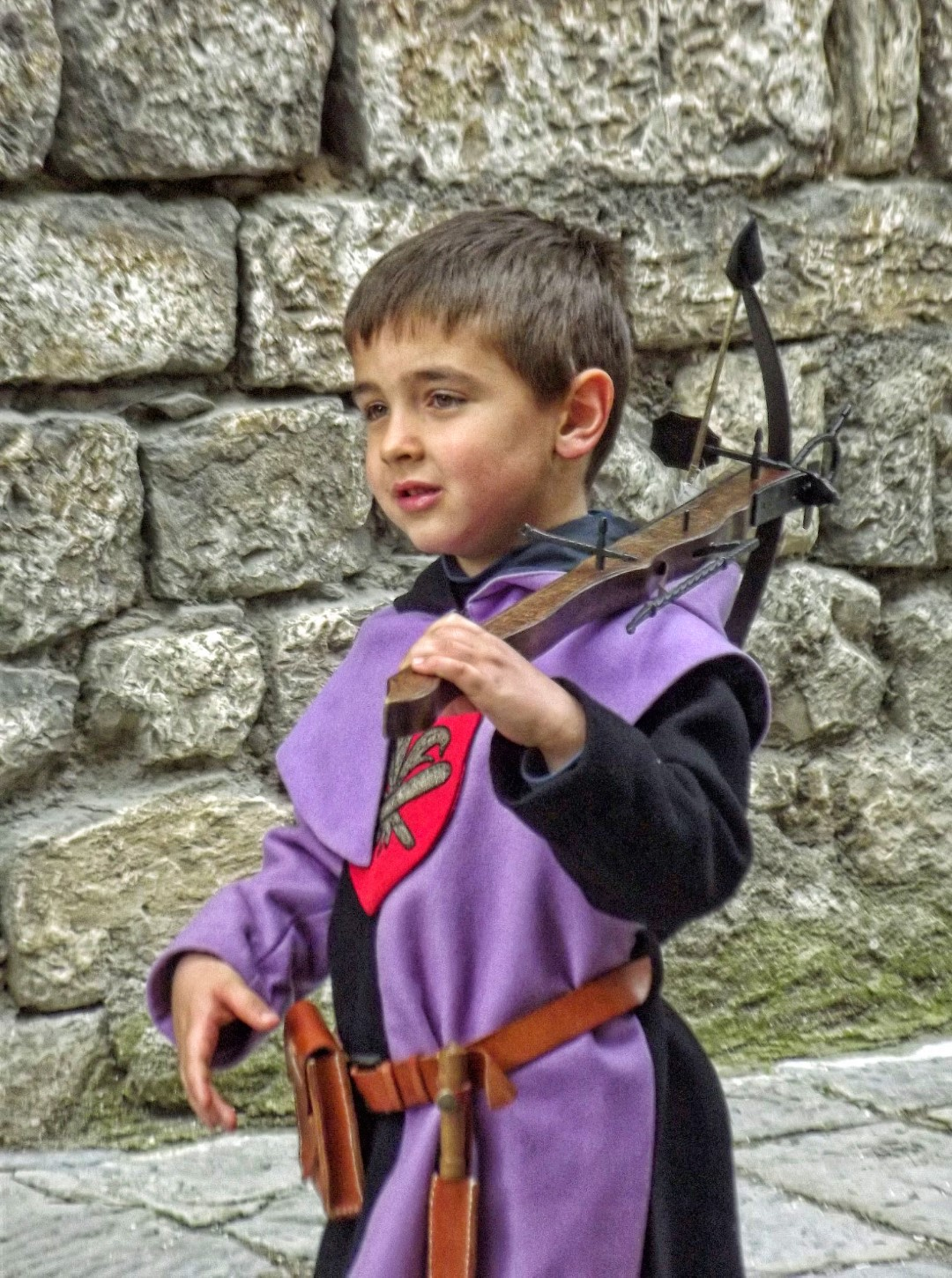 Young boy with crossbow