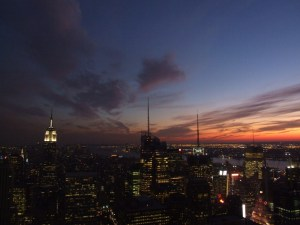 Dark sky with orange glow and skyscrapers