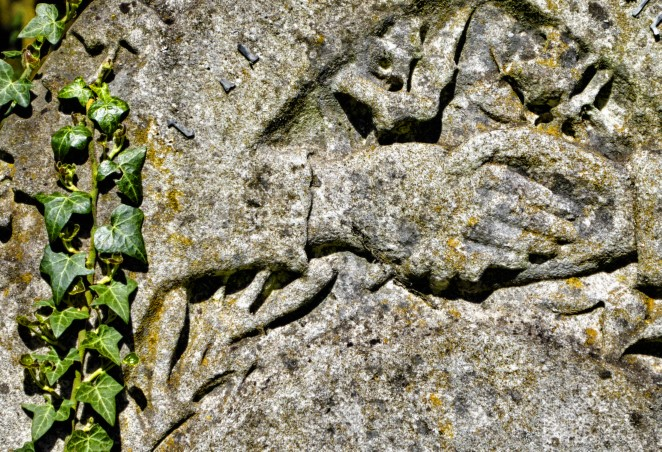 Stone carved with holding hands