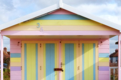 Wooden hut painted in candy stripes