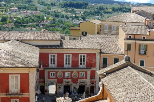 View down to an Italian town square and hills beyond