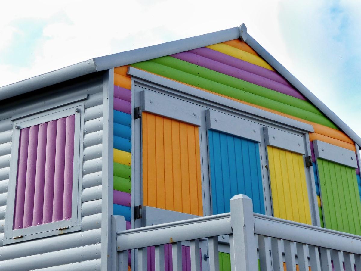 Wooden hut, multicoloured stripes