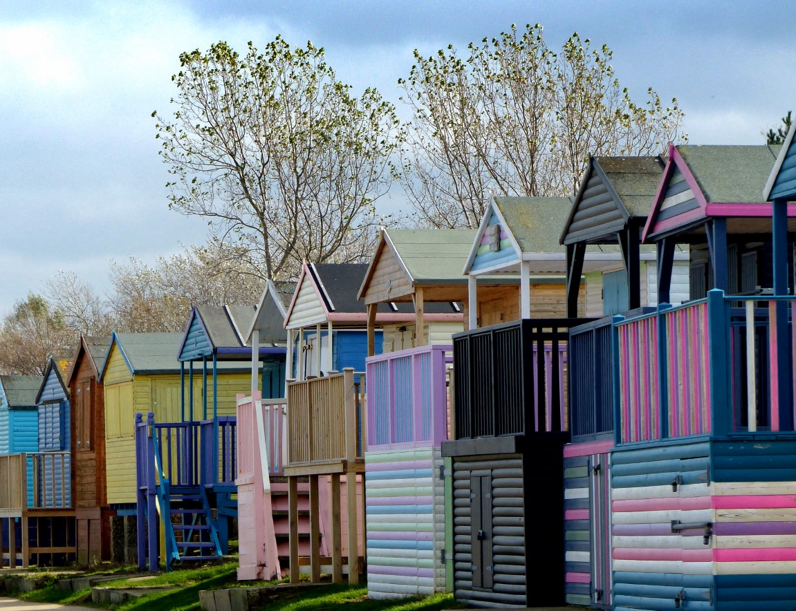 Row of wooden huts, assorted colours