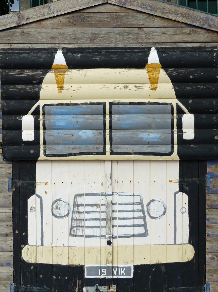 Wooden hut with painting of ice cream van on door