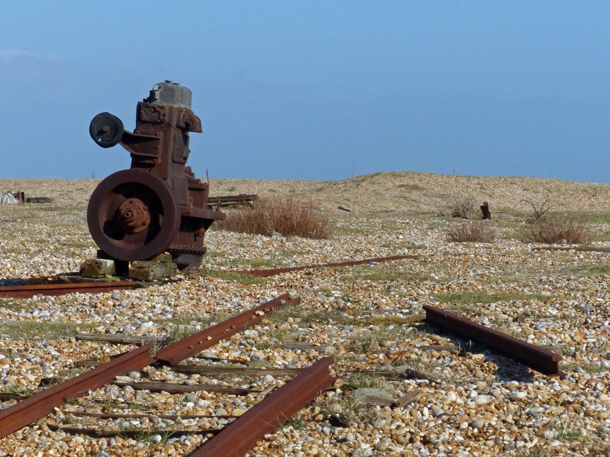 Rusting rail track on a shingle beach