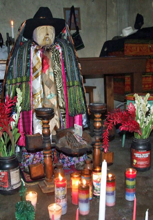 Clothed idol with candles