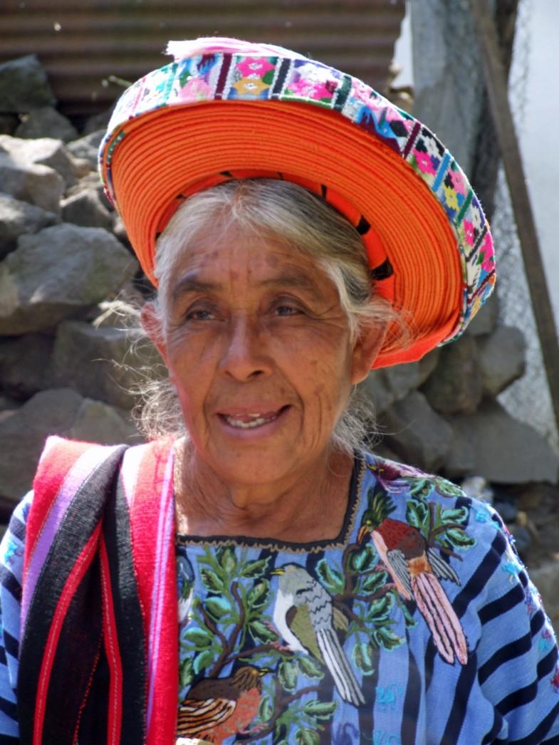 Woman in large coiled orange headdress