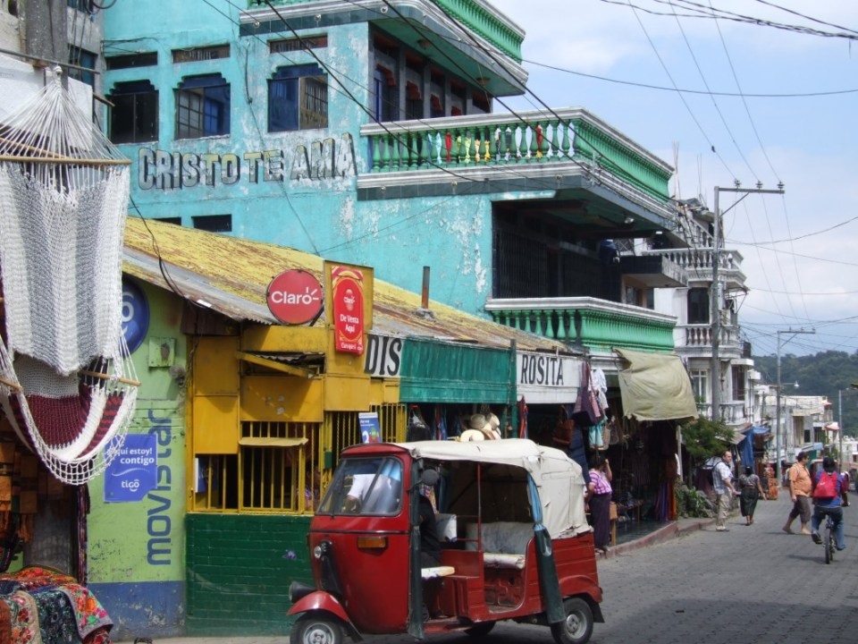 Street with colourful old buildings and tuk tuk