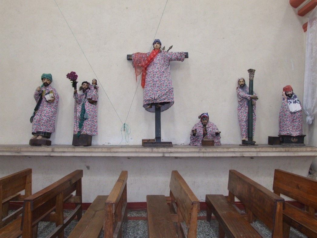 Statues of saints in fabric clothing