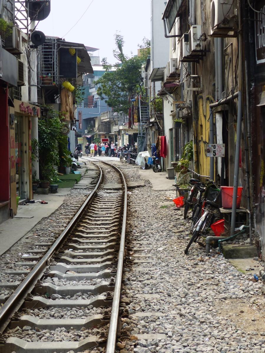 Railway line running between houses
