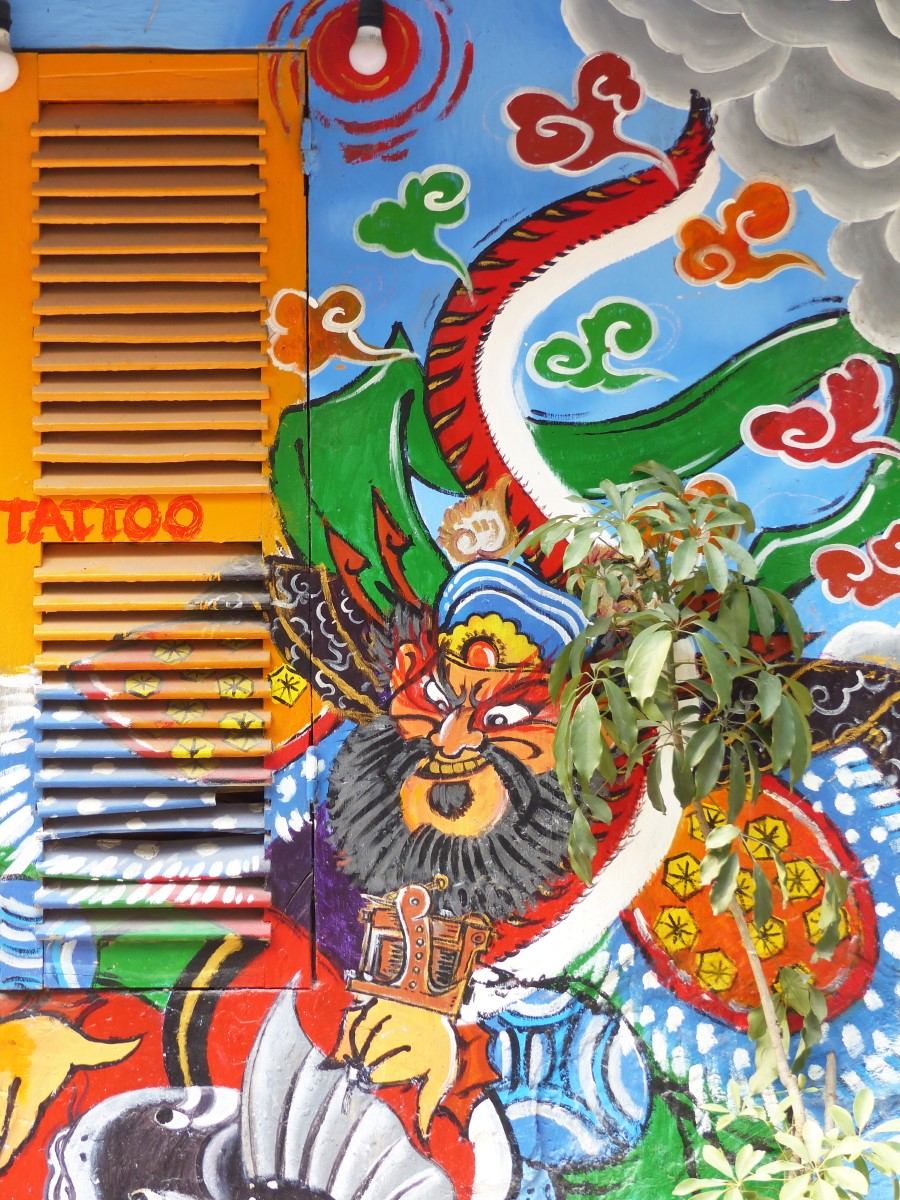 Mural with fierce man and snakes