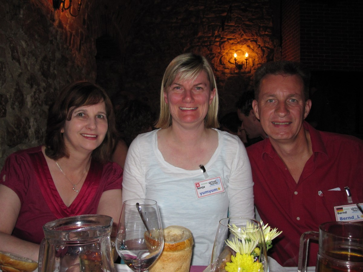 Three people at a dinner table