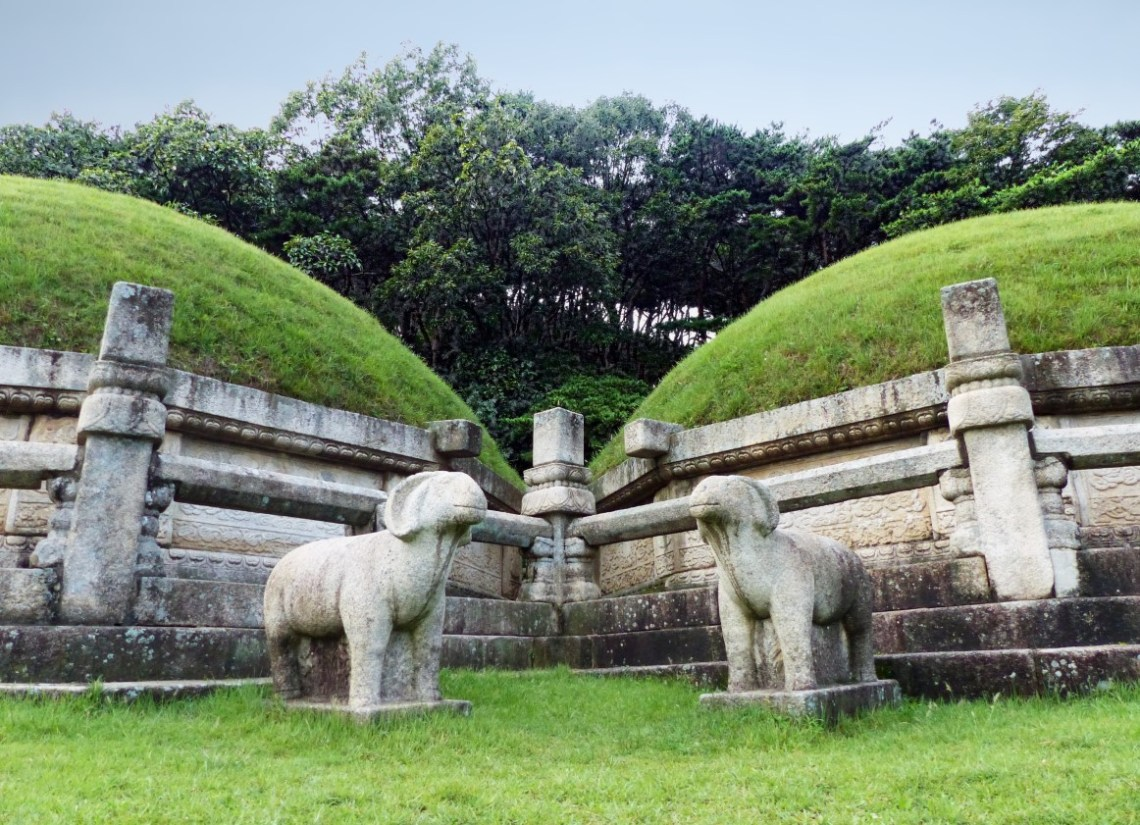 Grassy mounds and statues of sheep