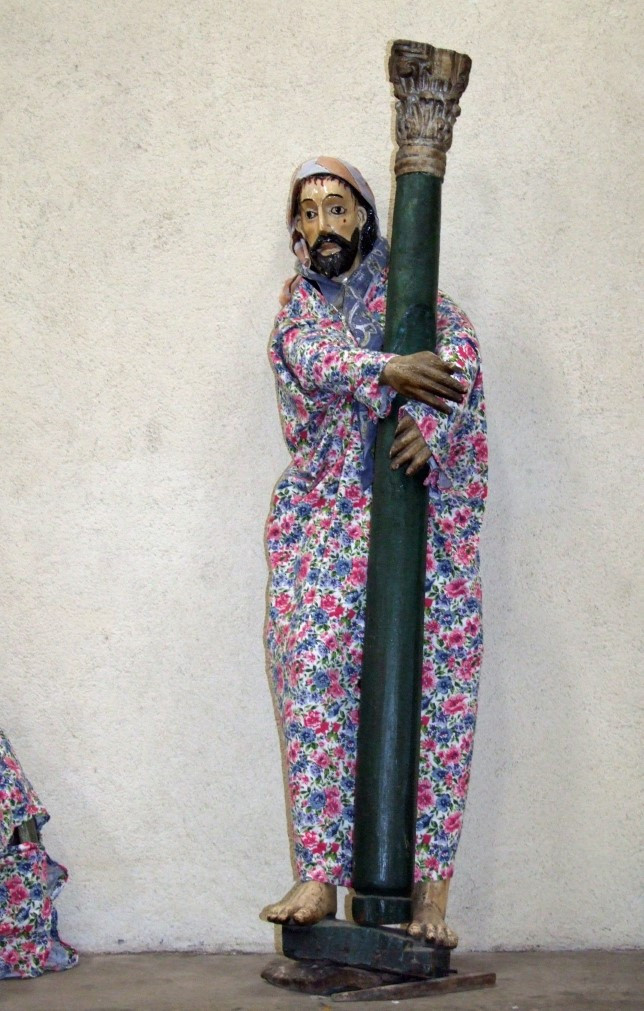 Statue of a saint clothed in fabric