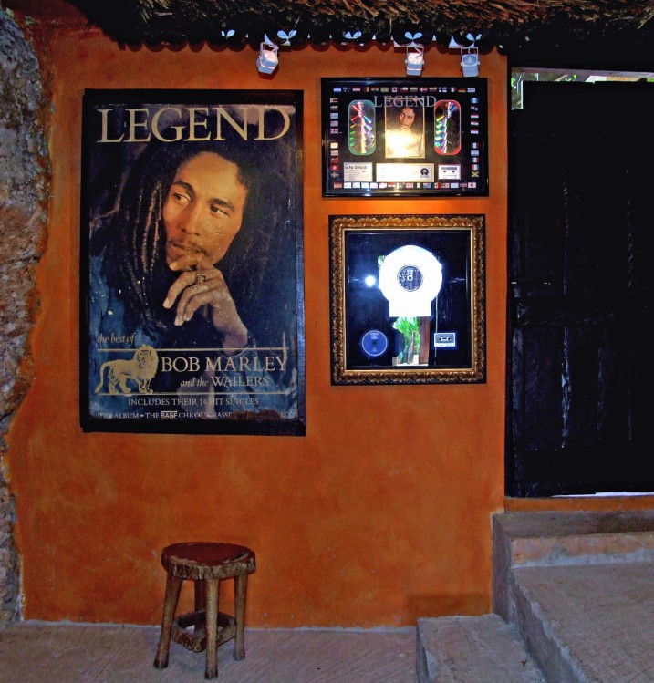 Wall with posters and gold discs