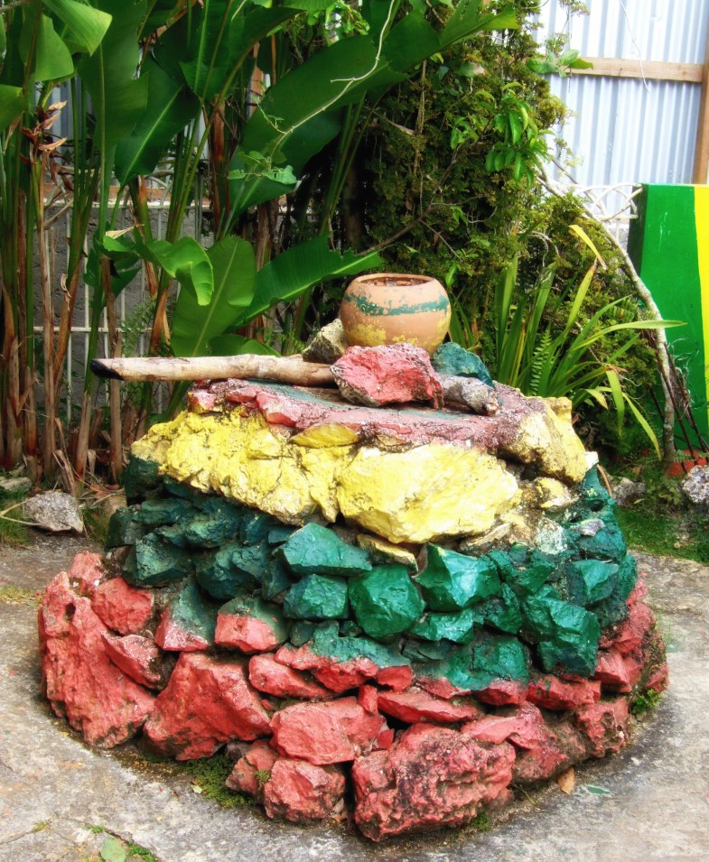 Cairn painted yellow, green and red