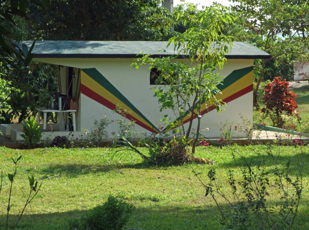 Small building with rastafarian colour stripes
