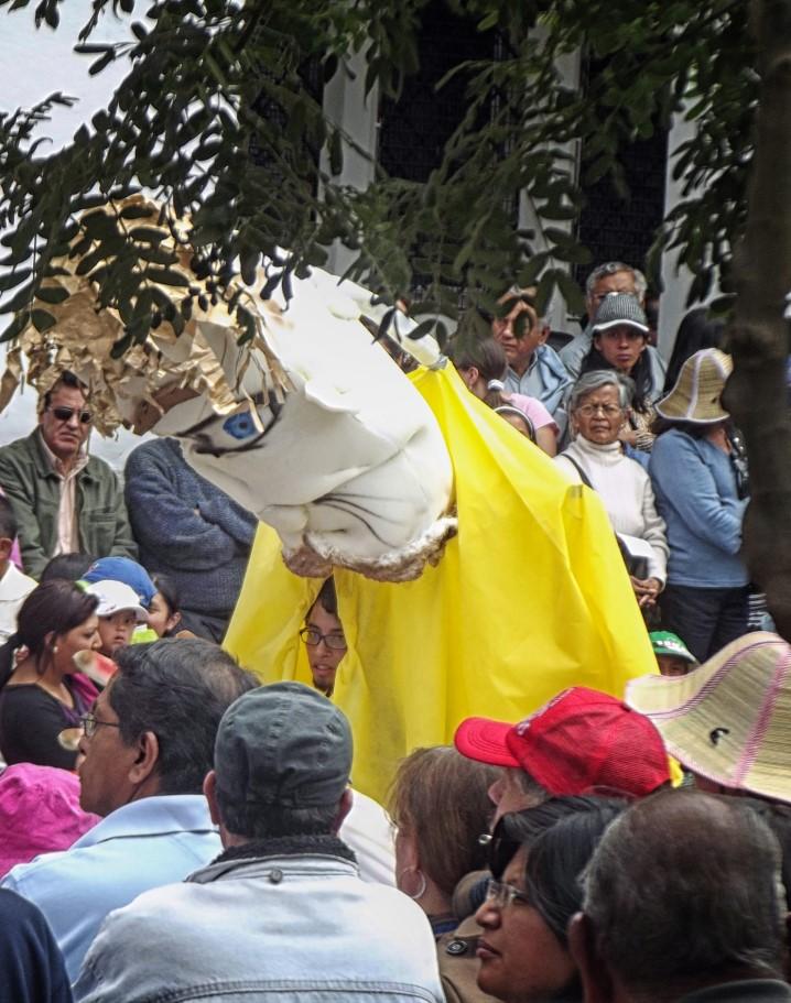Tall figure with papier mache head