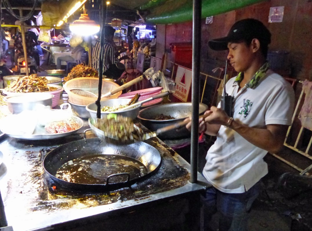 Man cooking at a street food stall