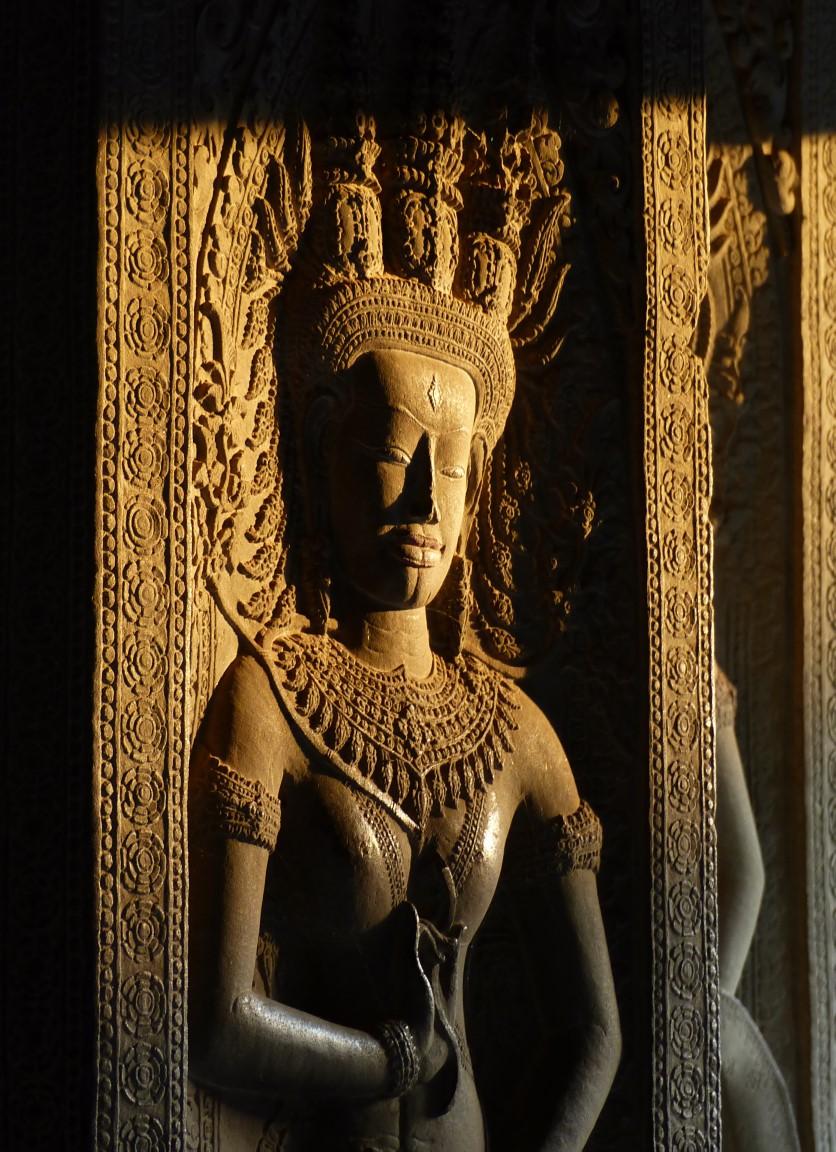 Carving of girl in ornate headdress